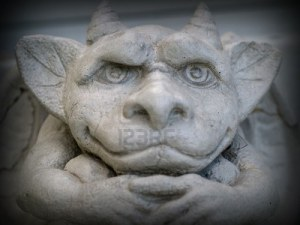 8903447-gargoyle-statue-emphasis-on-face-and-eyes-with-a-dark-border